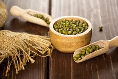 Dry green mung beans on brown wood royalty free stock photo