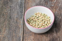 dry green peas, sugar pea in bowl on the wood board background Stock Photo