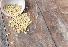 Dry green peas, sugar pea in bowl on the wood board background. Stock Photography