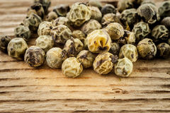 Dry green peppercorn  on wooden background Stock Images