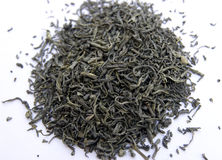 Dry green tea. With color of grey green,fouse in the middle.Background is white Stock Image