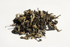 Dry Green Tea. Dry Chinese green tea on white background Stock Images