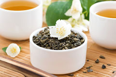 Dry green tea with jasmine and cups of tea Stock Photo