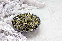 Dry green tea leaves on metal plate, horizontal, copy space Royalty Free Stock Images