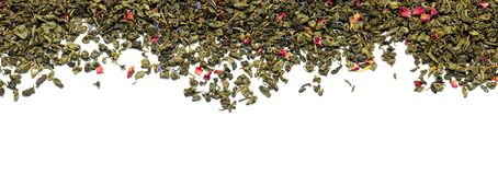 Dry green tea leaves on white background royalty free stock photography