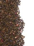 Dry green tea leaves on white background stock photos