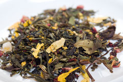 Dry green tea with petal colour and ginseng Royalty Free Stock Photos