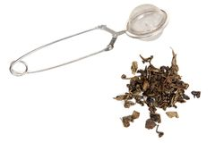 Dry green tea and strainer Stock Photography