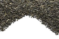Dry green tea on white background royalty free stock image
