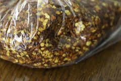 Dry ground red pepper in a bag. To season Nigerian Cooking stock photography
