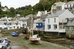 Dry harbour with boats aground, Polperro Stock Photography