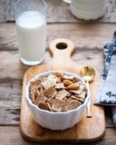 Dry healthy breakfast with nuts and a glass of milk royalty free stock photo