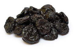 Dry and healthy prunes. isolated on white background.  Stock Photos