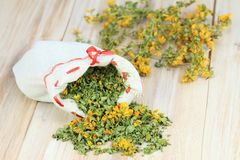 Dry herb St. Johns worth. Bag full of curative herb, lat. Hypericum perforatum stock image