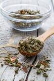Dry herb tea in wood spoon Royalty Free Stock Photos