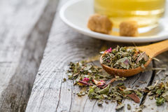 Dry herb tea in wood spoon Royalty Free Stock Images