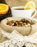 Dry herbal leaves and cup of tea Royalty Free Stock Image