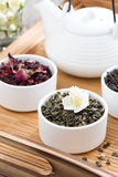 Dry herbal teas and kettle of freshly brewed tea Royalty Free Stock Photo