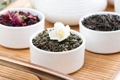 Dry herbal teas in white bowls on a tray Stock Image