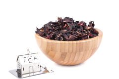 Dry Hibiscus in a wooden bowl Stock Photo