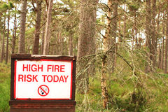 Dry Highland Forest with Fire Risk Sign Royalty Free Stock Photography