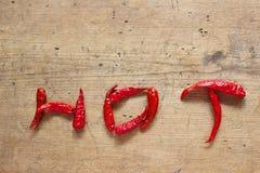 Dry hot chili. On wood background Stock Photography