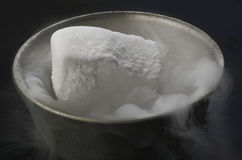 Dry ice in bowl Stock Photography