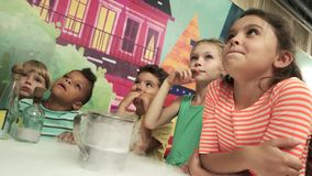 Dry ice experiment for kids. Chemistry lessons for kids with steaming liquid. Tricks for kids stock footage