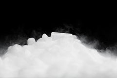 Dry ice with vapor. On black Royalty Free Stock Images