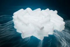 Dry ice with vapour. On blue background Royalty Free Stock Photography