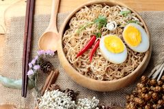 Dry Instant noodles cooked put egg Stock Image