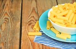 Dry italian pasta in a ceramic bowl Royalty Free Stock Photo