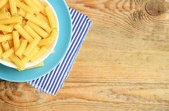 Dry italian pasta in a ceramic bowl Stock Image