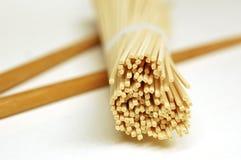 Dry Japanese Ramen Noodles. Close-up of dry ramen noodles and chopsticks Stock Image