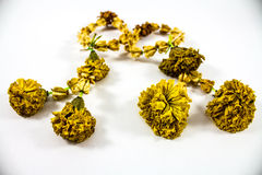 Dry jasmine garland with calendula flowers Royalty Free Stock Photo