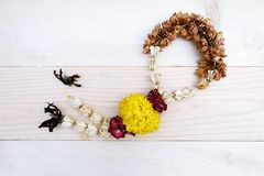 Dry Jasmine and Rose Flower Wreath Thai. On the Table Wooden Stock Photography