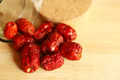 Dry jujube on wood cut plate scene. royalty free stock photography