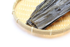 Dry kelp on a bamboo colander Royalty Free Stock Photography