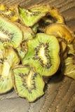 Dry kiwi. A pile of dry kiwis, on wooden background Stock Photos