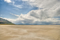 Dry lake bed and clouds Royalty Free Stock Images