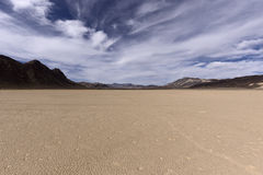Dry lake bed in desert with cracked mud on a lake floor Stock Image