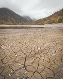 Dry lake bed at Lake Kruth-Wildestein in autumn with cracked dry bottom of lake royalty free stock images