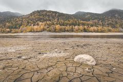 Dry lake bed at Lake Kruth-Wildestein in autumn with cracked dry bottom of lake royalty free stock photo