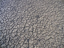Dry lake bed with natural texture of cracked clay in perspective Royalty Free Stock Photography