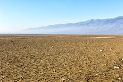 Dry lake bed with natural texture of cracked clay in perspective Stock Photos