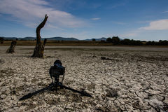 Dry lake in the desert and tripod. Tripod to dry lake in a desert Royalty Free Stock Photo
