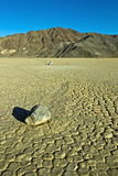 Dry lake feature with sailing stones Royalty Free Stock Image