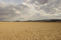 Dry Lakebed. An expansive dry lakebed in the desert Stock Photos