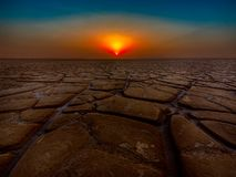 Dry land. Dry craked land symbolic to climate change and Global warming royalty free stock photo