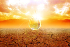 Dry Land. A water drop in arid land stock illustration